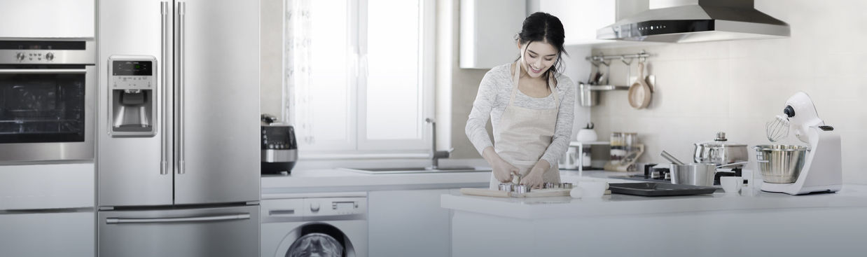 Smiling woman cooking in modern kitchen